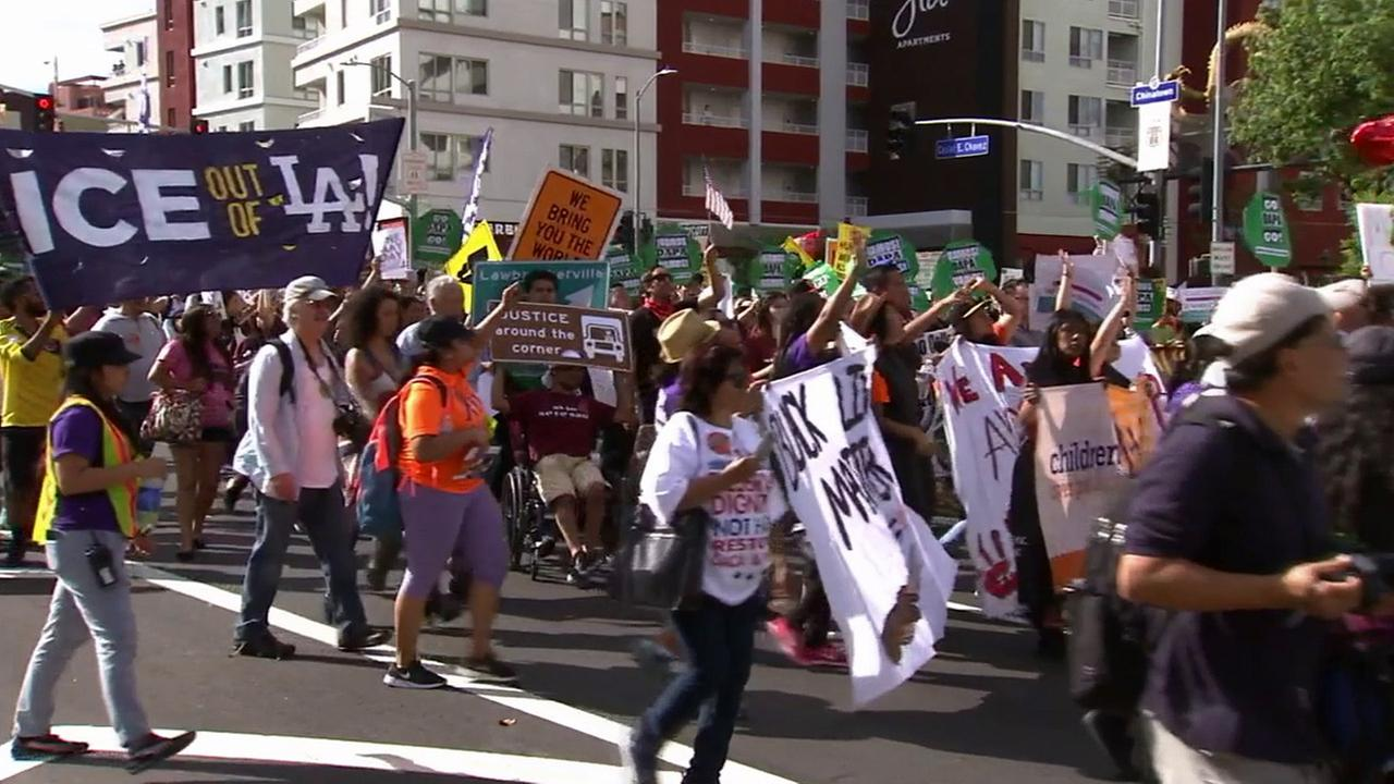 Thousands of people gathered in downtown Los Angeles Friday, May 1, 2015, for May Day marches.