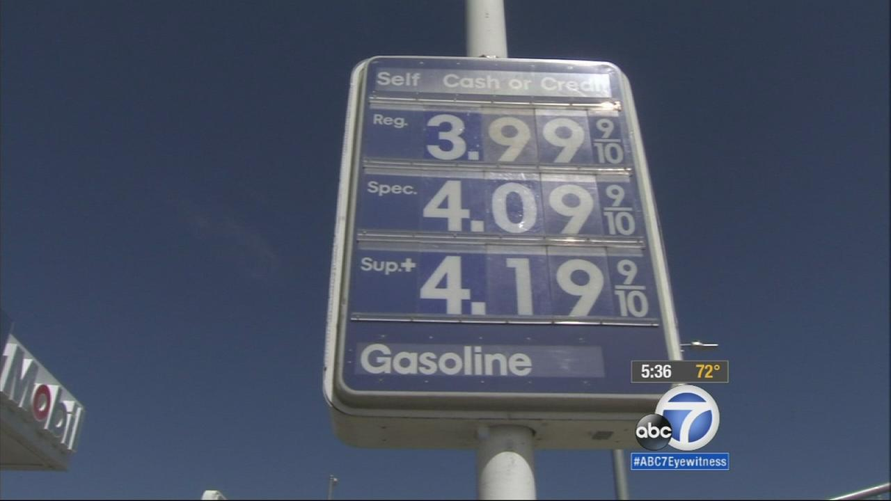 A sign at a Mobile gas station shows prices reaching above $4 on Friday, May 1, 2015.