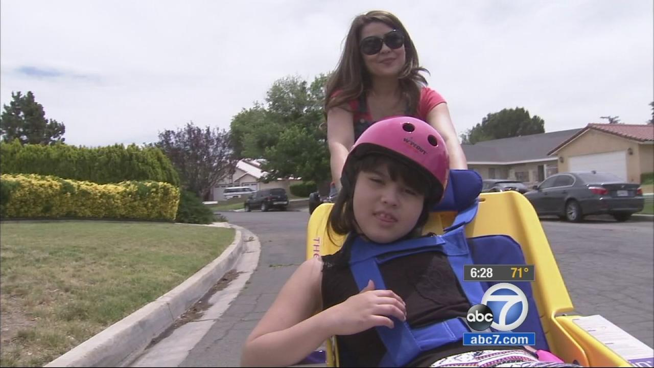 Ashlynn Aguilera, a quadriplegic Victorville girl born with multiple disabilities, including cerebral palsy and epilepsy, enjoyed a bike ride with her family.