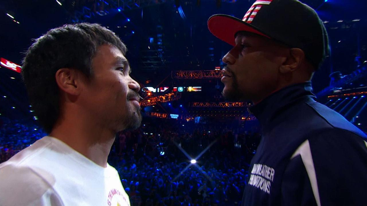 Manny Pacquiao and Floyd Mayweather, Jr. face one another for the cameras during their weigh-in on Friday, May 1, 2015.