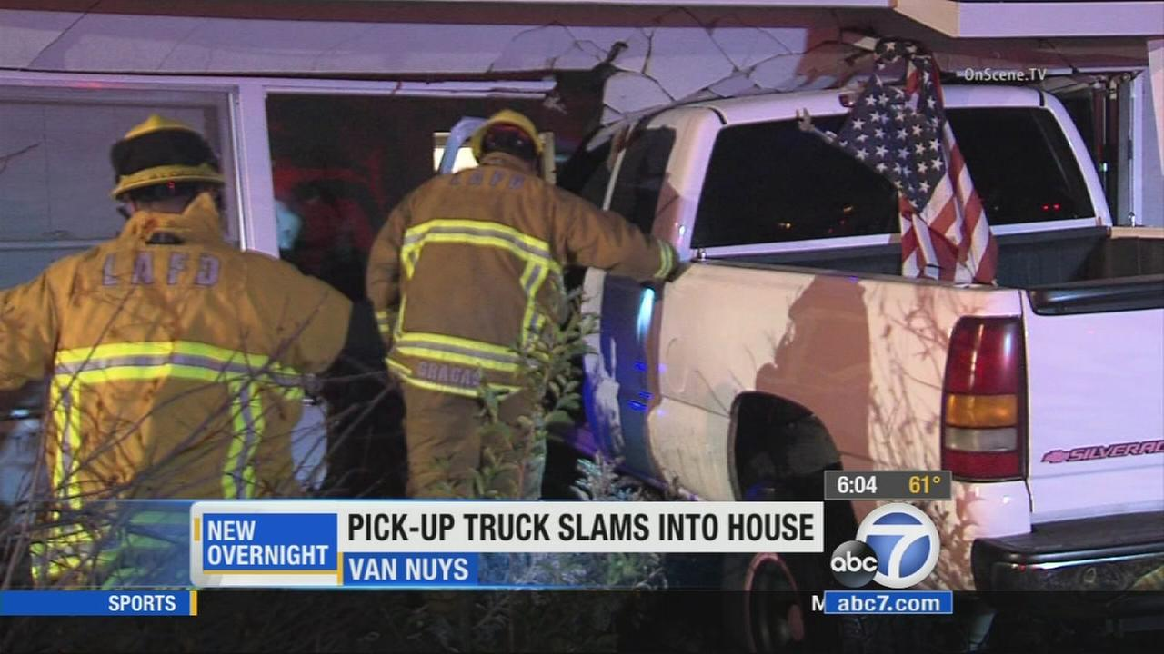 A pickup truck crashed into the living room of a Van Nuys home on Wednesday, May 6, 2015.