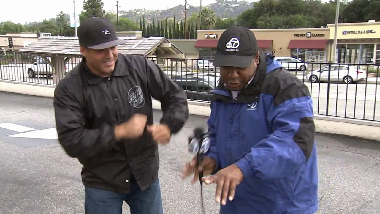 Reporter Leo Stallworth calls for more rain in a special dance with an Eyewitness News viewer on Friday, May 8, 2015.