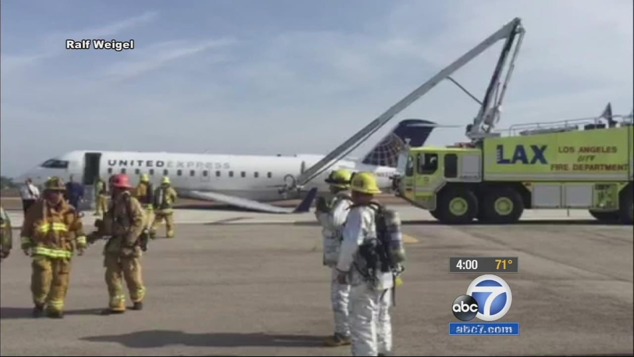 A plane experiencing mechanical issues made a belly landing safely at Los Angeles International Airport on Monday.