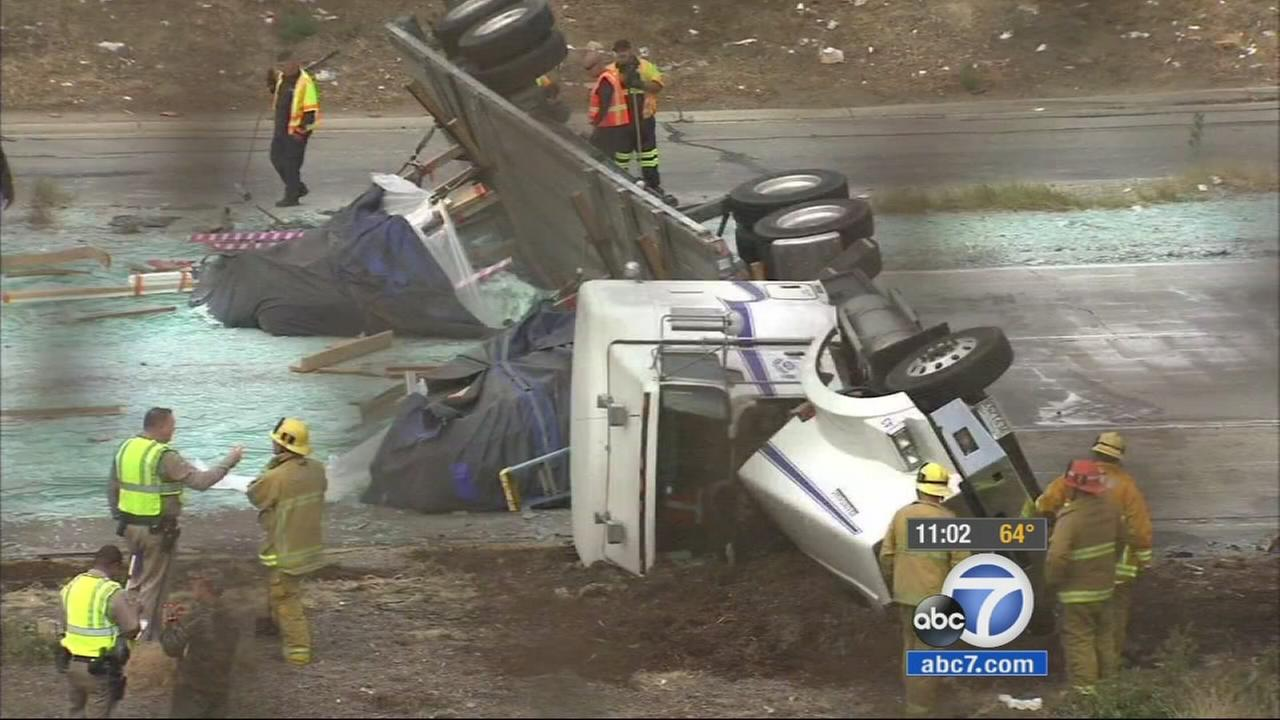 A big rig that was hauling glass overturned on the 5 South in Boyle Heights on Monday, May 18, 2015.