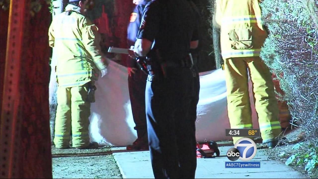 An investigation is underway after police discovered a burned body on the sidewalk in South Los Angeles early Monday morning.