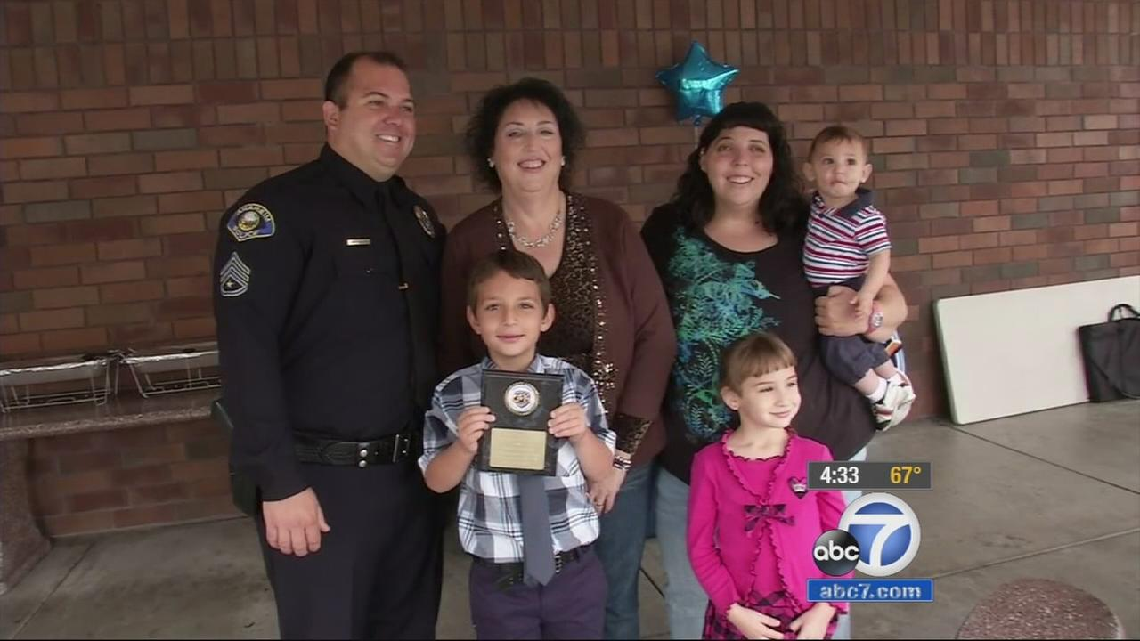 Logan Abrams poses for a photo with his family after receiving an award from the Anaheim Police Department on Wednesday, May 20, 2015.