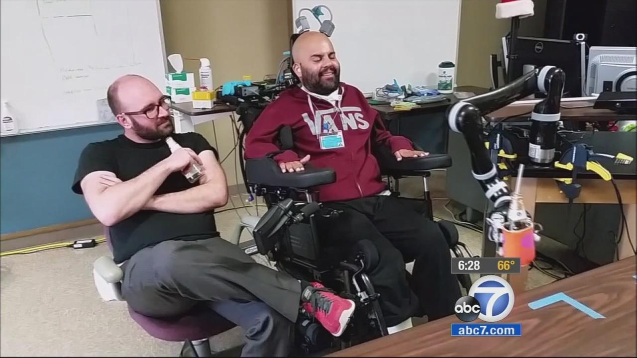 A paralyzed man is able to use a robotic arm all thanks to computer chips implanted into his brain.