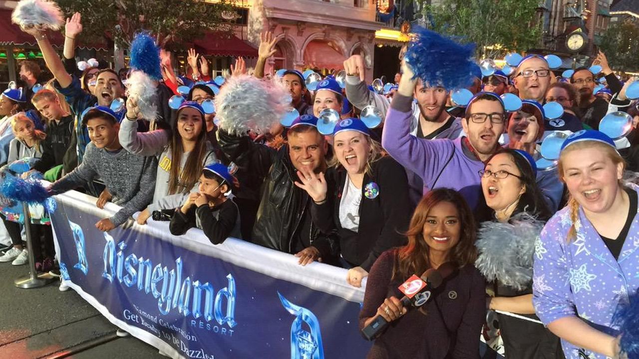 ABC7 reporter Darsha Philips hangs out with a group of Disney fans who await entrance into the park on Friday, May 22, 2015.