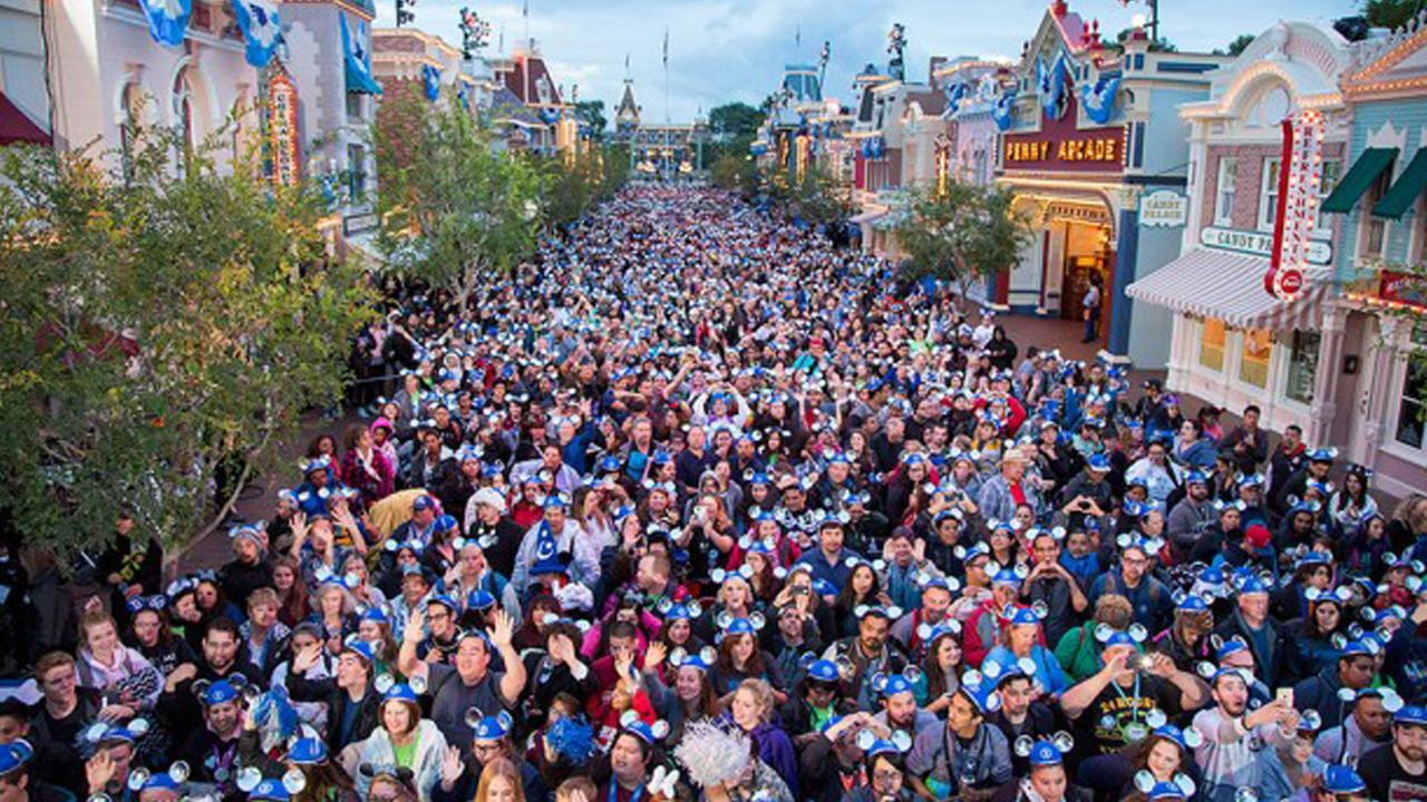 Thousands of people flow into Disneyland Park for the 24-hour Diamond Celebration on Friday, May 22, 2015.