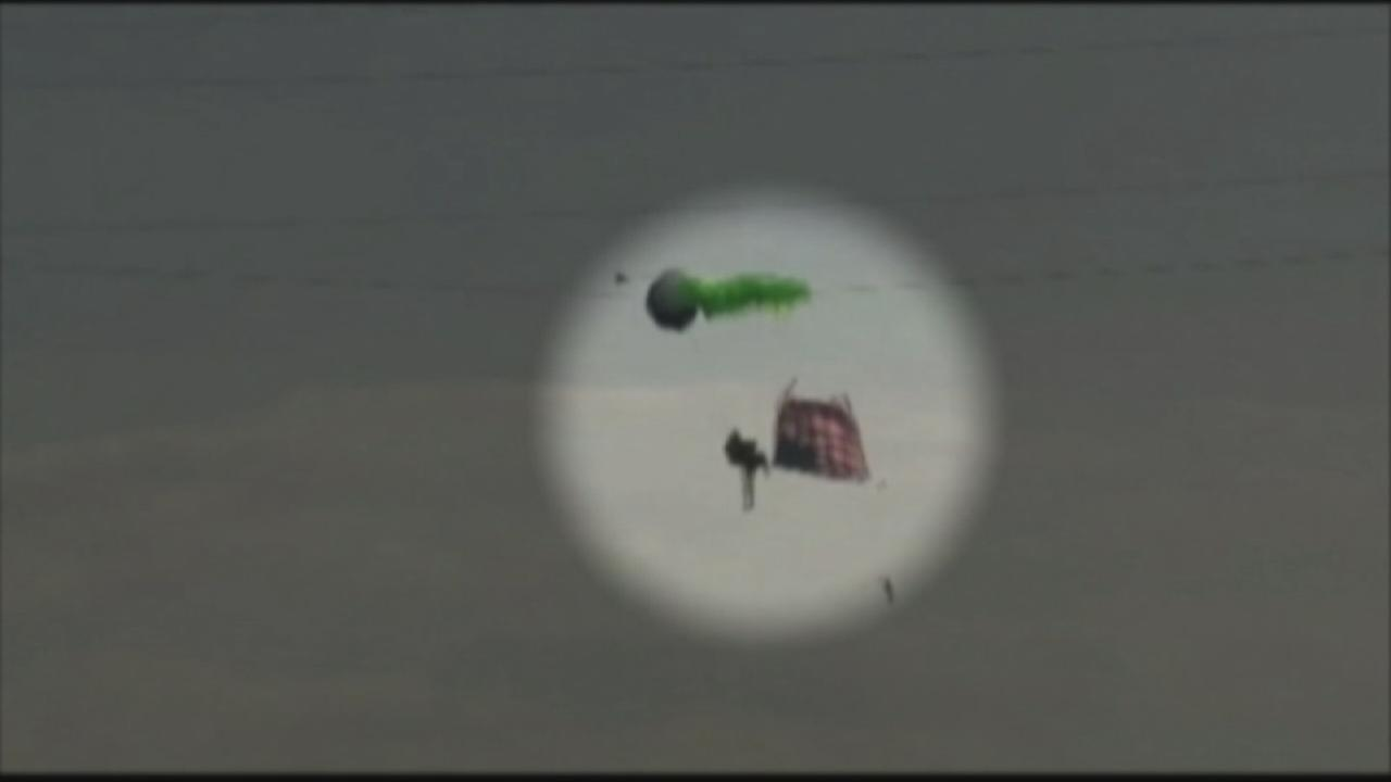 A skydiver in Tennessee had just jumped from a plane carrying an American flag when the winds carried him into the power lines.