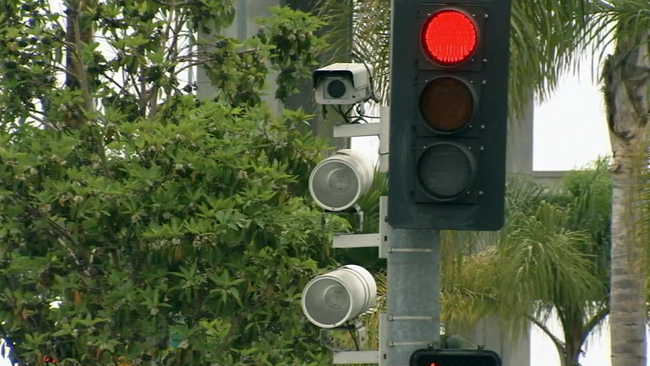 A camera set up to catch drivers who run red lights in Beverly Hills is shown in this undated file photo.