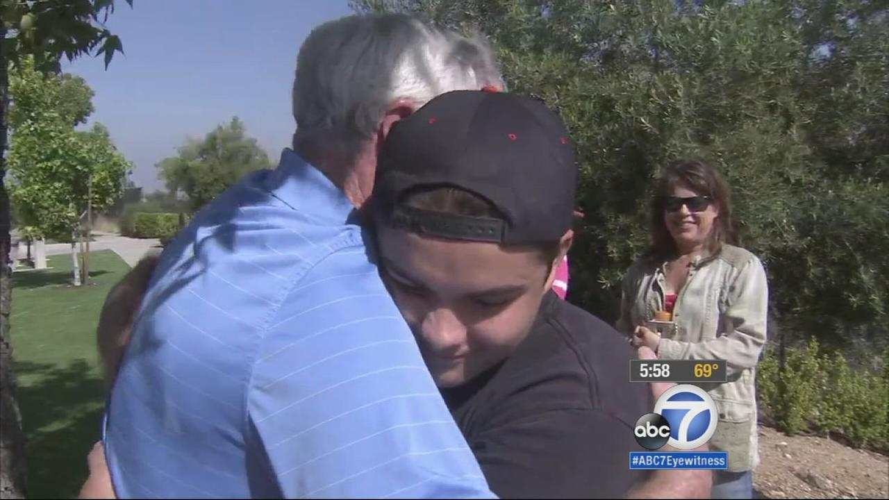 Matt Hawker hugs Jack Emberton, the grandfather of the 5-year-old boy Matt saved from a house fire in Rancho Cucamonga.