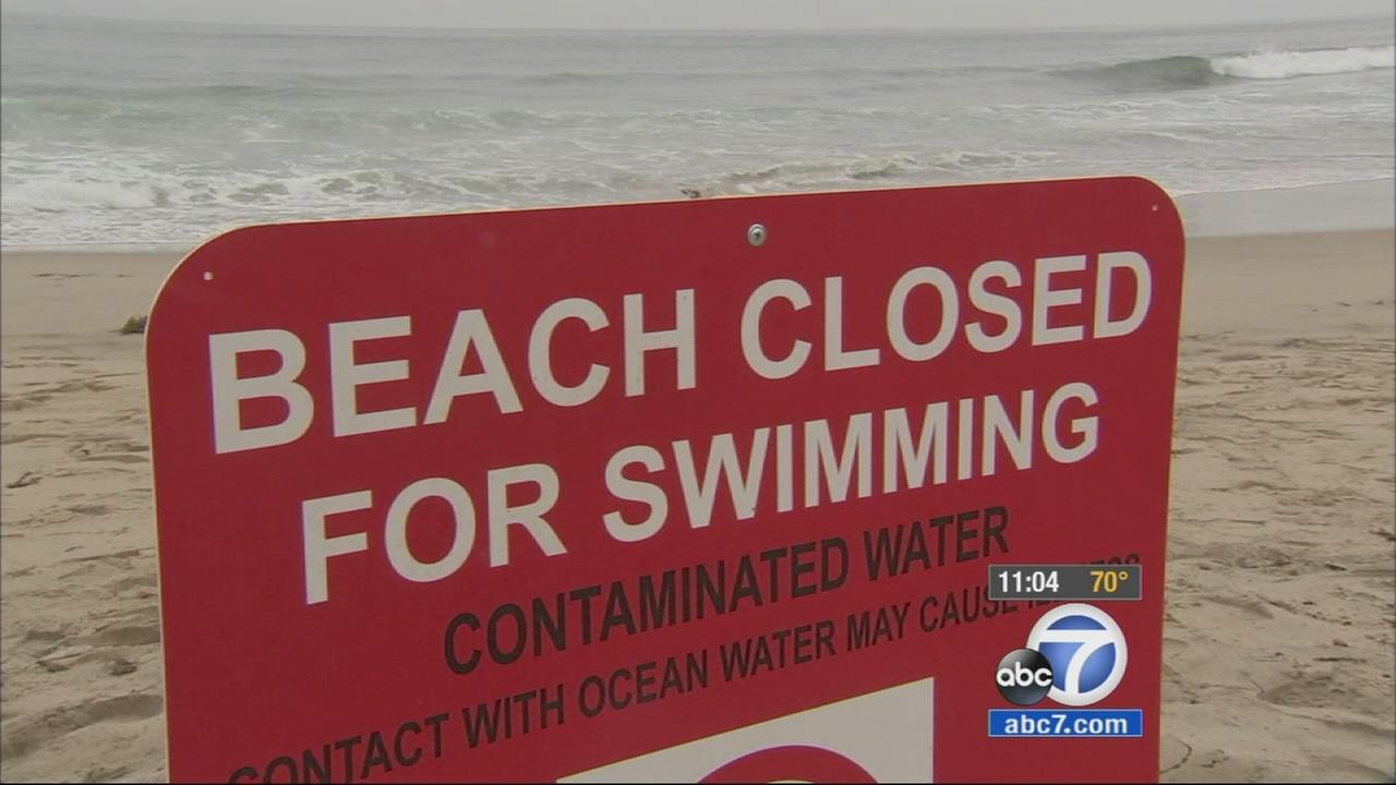 Citing public safety, a 7-mile stretch of South Bay beaches remain closed on Friday days after oily substance washed ashore.