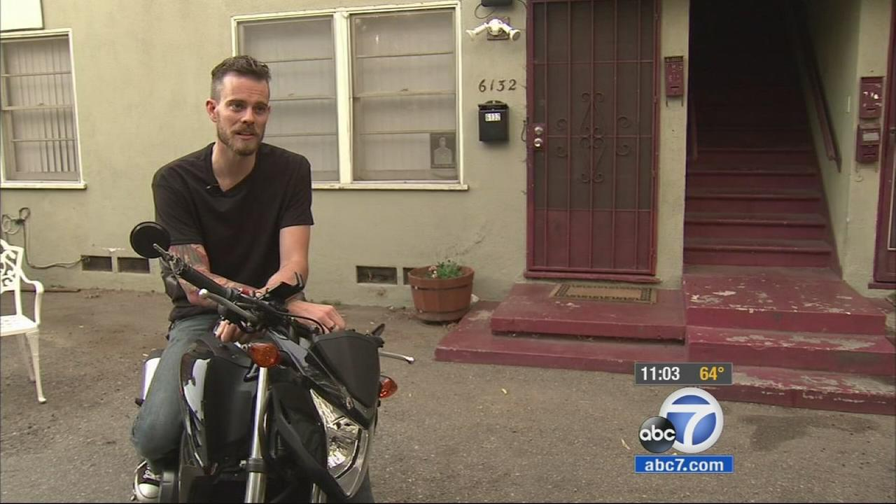 Motorcyclist Samuel Ayres who called out a driver for texting in West Hollywood was allegedly run over by the same driver in an apparent road rage crash.