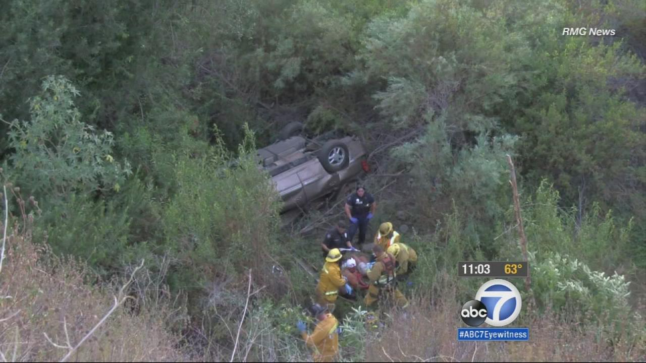 Two children were killed after a car plunged at least 40 feet over the side of the road and into a ravine in Azusa on Saturday.