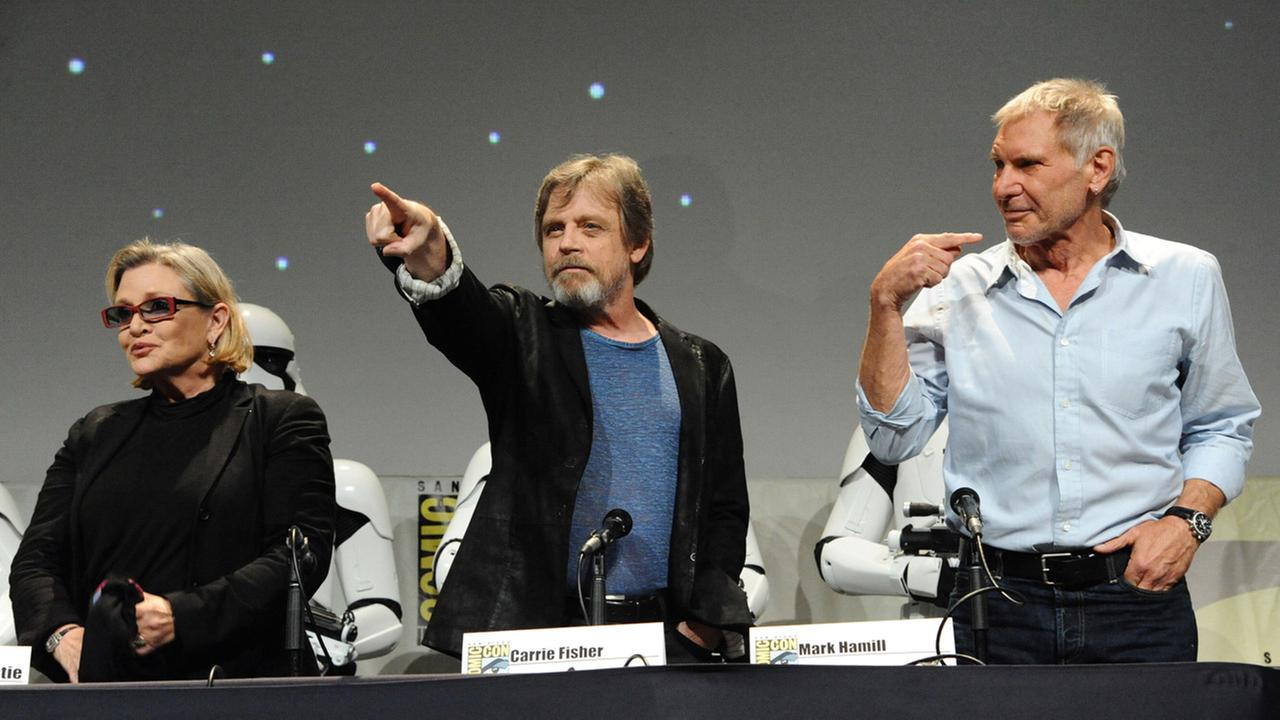 Carrie Fisher, Mark Hamill, and Harrison Ford attend Lucasfilms Star Wars: The Force Awakens panel on day 2 of San Diego Comic-Con International on Friday, July 10, 2015.