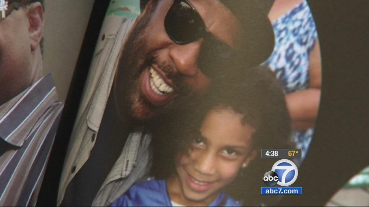An image of Terry Carter with one of his daughters is shown in an undated photo.