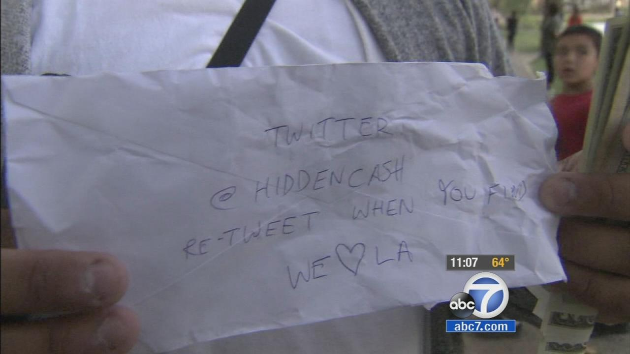 An envelope from mystery millionaire @HiddenCash is seen on May 30, 2014.