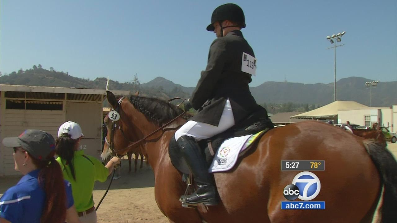 A Special Olympian rides a horse during an equestrian event at the Special Olympics World Games in Los Angeles.