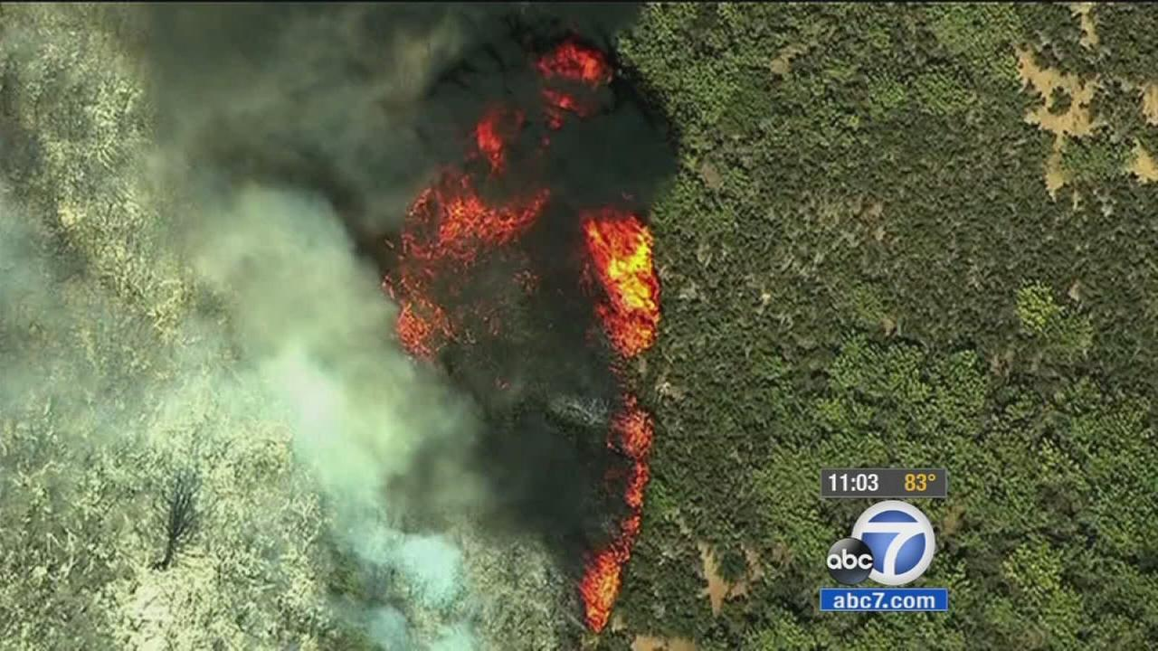 Fire officials say the Rocky Fire, which is burning in Lake, Colusa and Yolo counties, has spread to 65,000 acres after flames jumped a containment line.