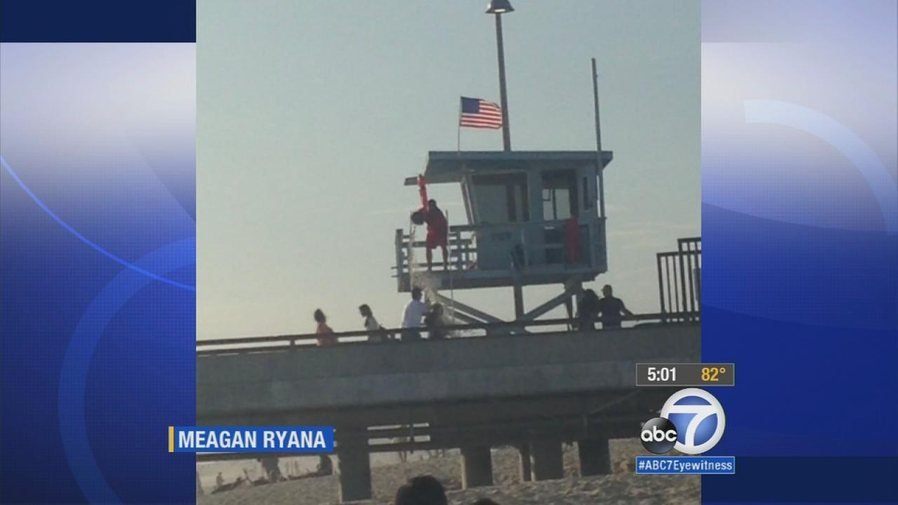 New video reveals that the Los Angeles County lifeguard attacked at Venice Pier last week had poured a bucket of water on a man and woman from his tower.