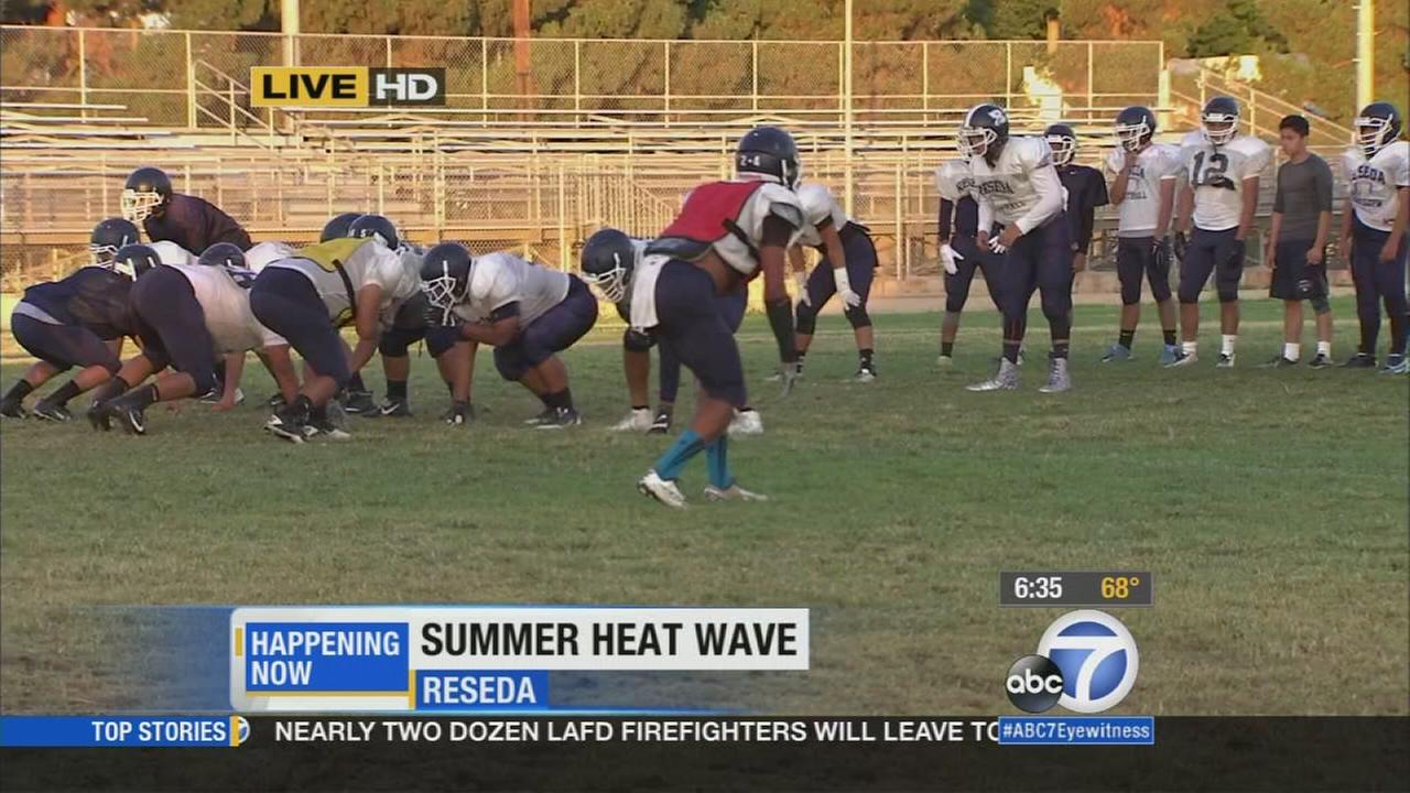 Reseda High School football players hit the field early for practice Thursday morning to avoid the scorching sun later in the day.