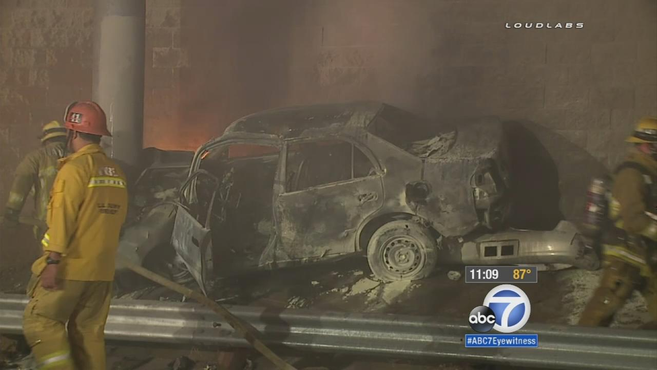A driver escaped a fiery crash on the side of the freeway in Paramount thanks to some Good Samaritans who came to the rescue on Thursday, Aug. 13, 2015.