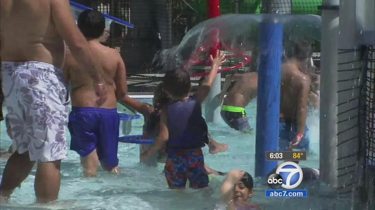 Families and children had fun at a pool in Burbank on Saturday, Aug. 15, 2015.