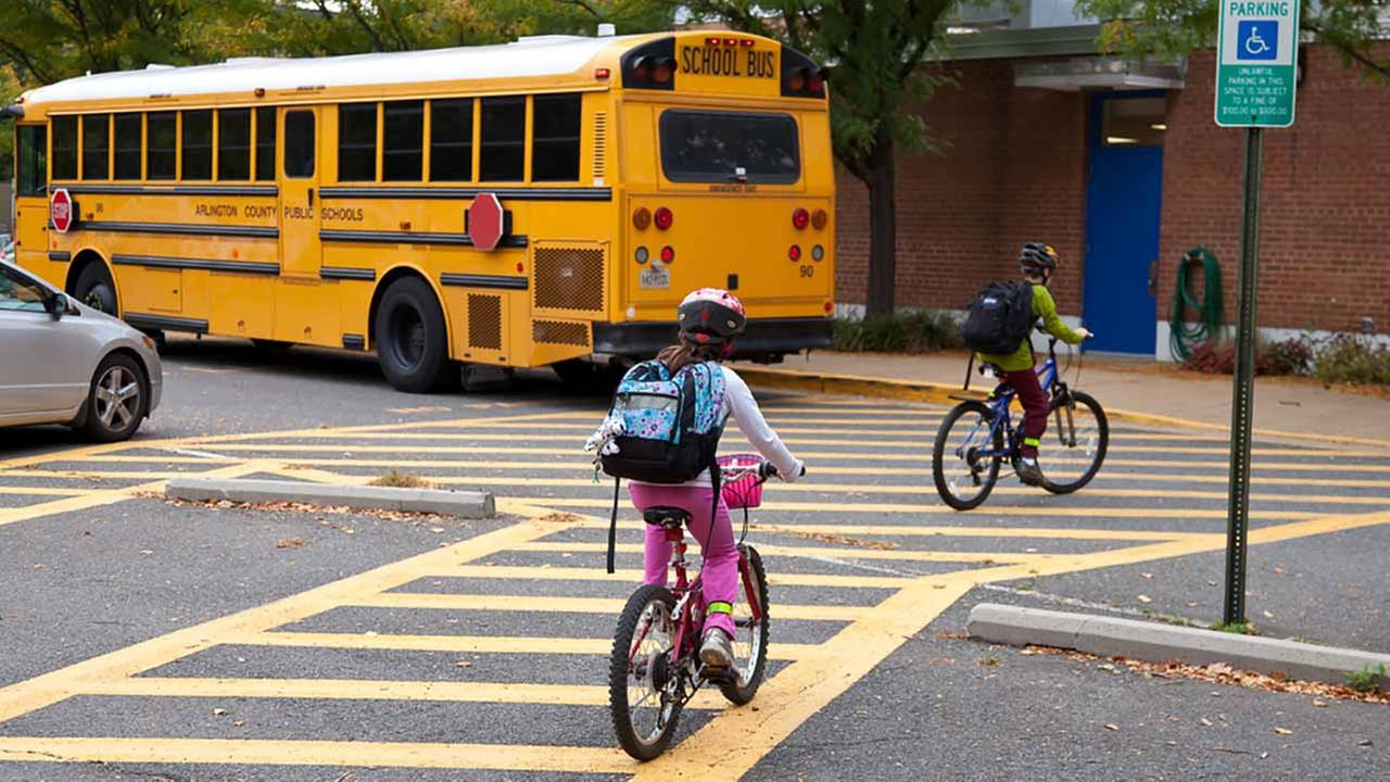 Children ride their bikes to school.