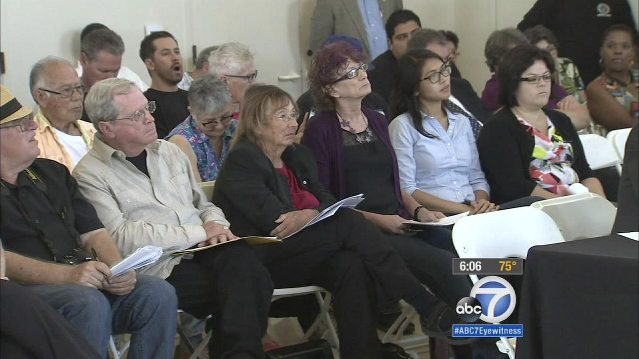 A group of concerned citizens gather for a town hall meeting regarding the recent power outages in downtown Long Beach.