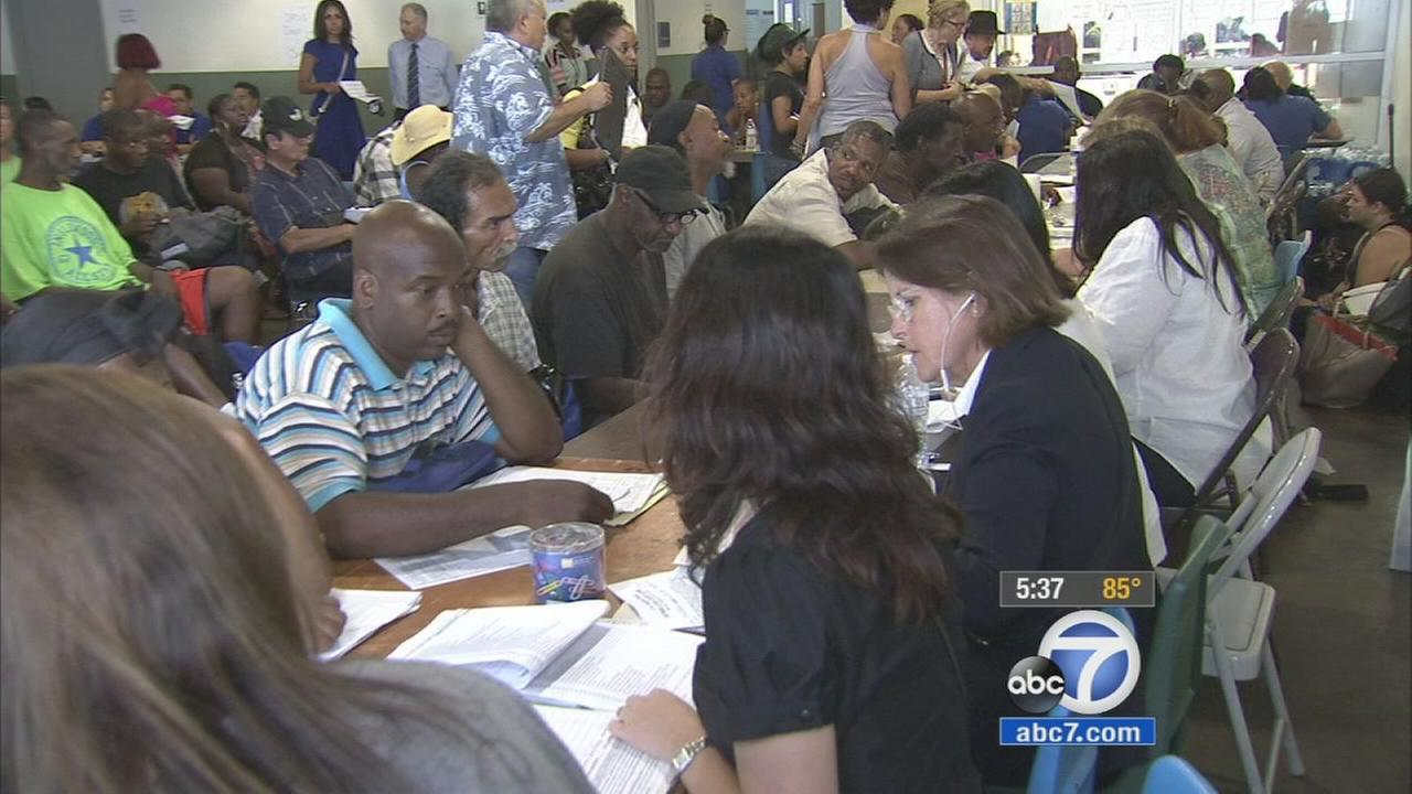 Many gathered at Midnight Mission in downtown Los Angeles Skid Row area to get help from a program that gives second chances to those in need on Wednesday, Aug. 26, 2015.