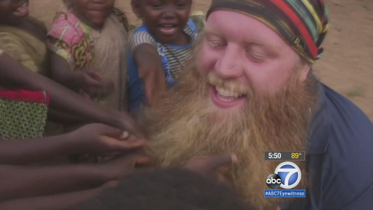 Justin Wren with Pygmy children is shown in an undated photo.