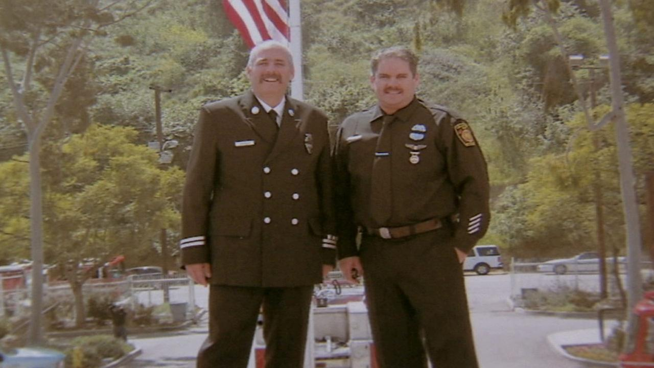 Rich Robinson, left, is standing with his brother Steven Robinson in an undated photo.