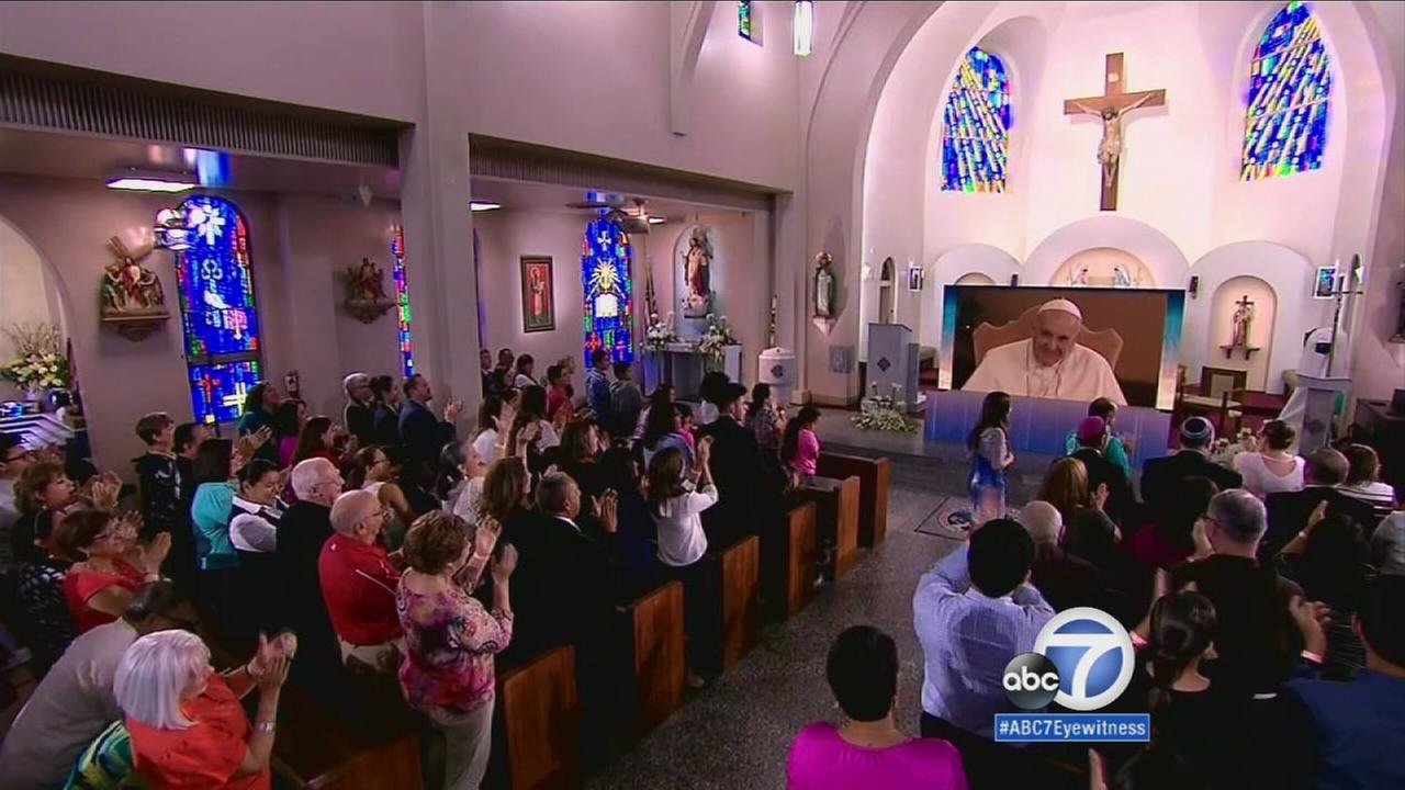 Audiences from Chicago, Los Angeles and McAllen, Texas tuned into a virtual satellite feed with Pope Francis on Monday, Aug. 31, 2015.