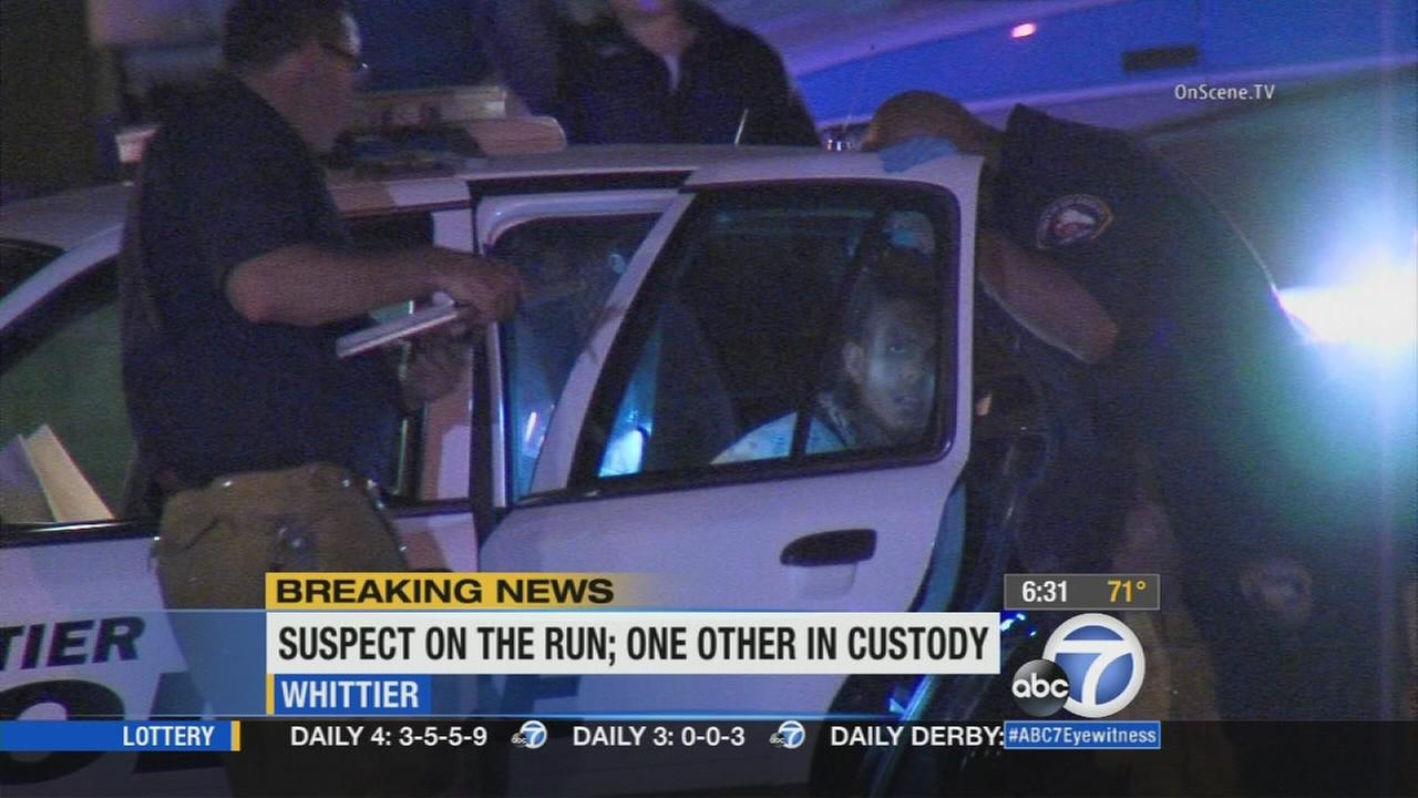 One of the suspects involved in the police shooting in Whittier was taken into custody on Tuesday, Sept. 1, 2015.