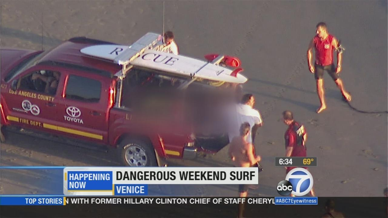 Lifeguards and first responders pulled a man from the water off Venice Beach after he got caught in a rip current on Thursday, Sept. 4, 2015.