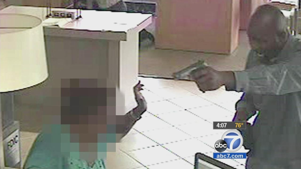 One of two bank robbery suspects is shown in surveillance video caught on a camera at City National Bank in Los Alamitos on Friday, Sept. 4, 2015.