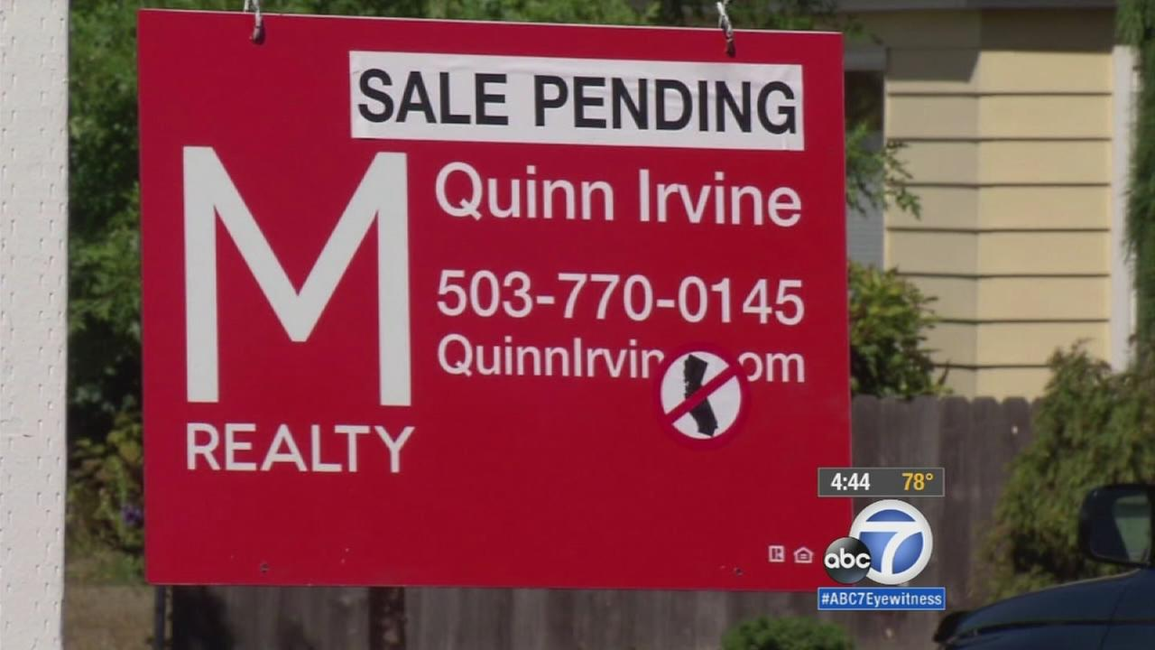 A home-for-sale sign is posted with an anti-California sticker is shown in an undated photo.