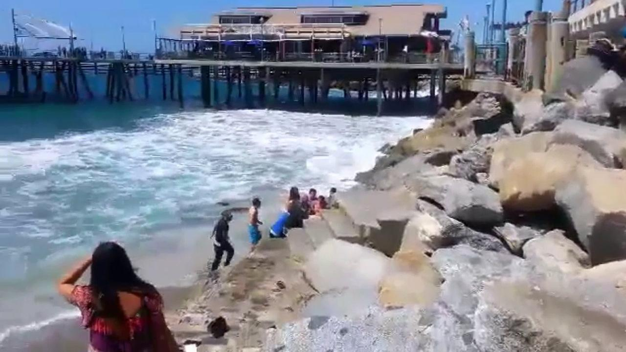 Cellphone video from witnesses at Redondo Beach captured people trying to resuscitate a man on Saturday, Sept. 5, 2015.