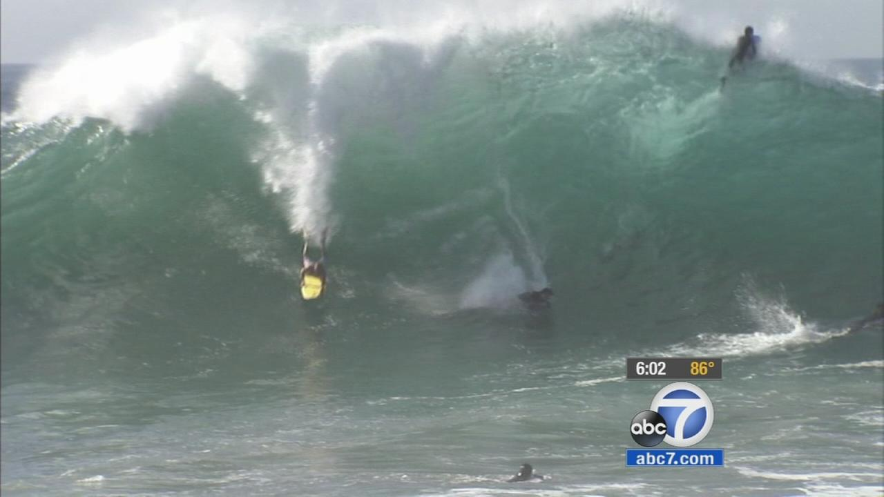 Surfers and boogie boarders tried to handle a massive wave at the Wedge in Huntington Beach on Monday, Sept. 7, 2015.