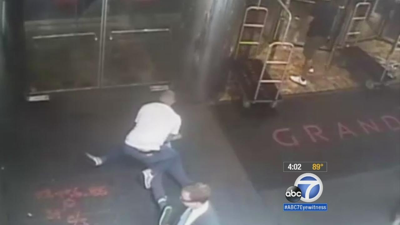 Video surveillance released of the mistaken arrest of former tennis star James Blake shows a plainclothes police officer grabbing Blake by the arm and tackling him to the ground.