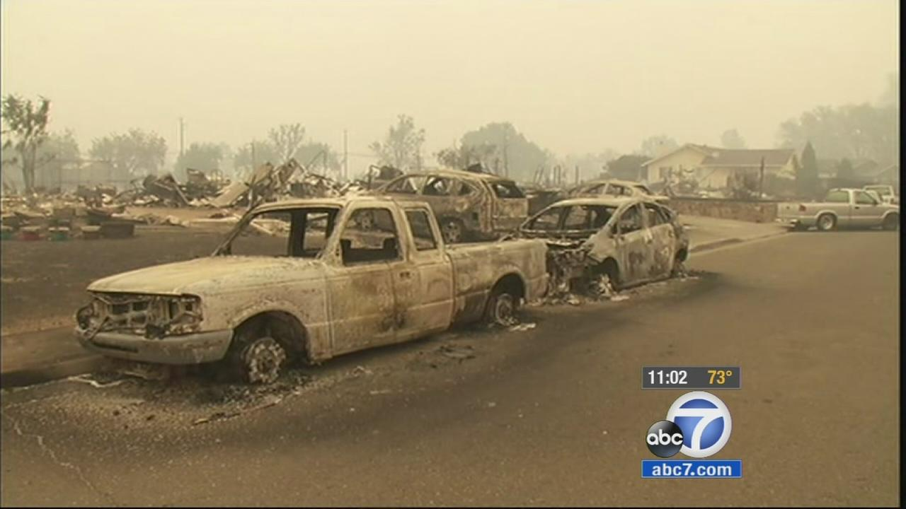 The charred remains of an entire neighborhood and cars sit in Middleton after the Valley Fire ripped through the area in Northern California.