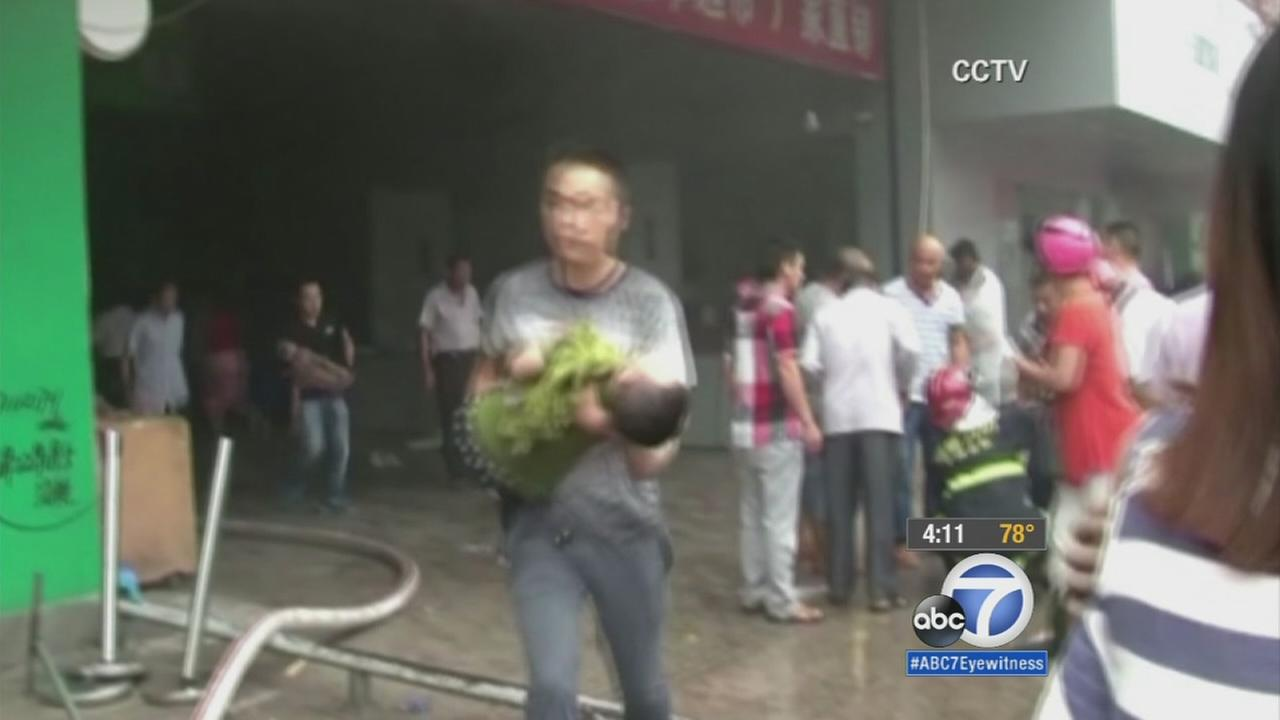Trapped children rescued from burning building in China