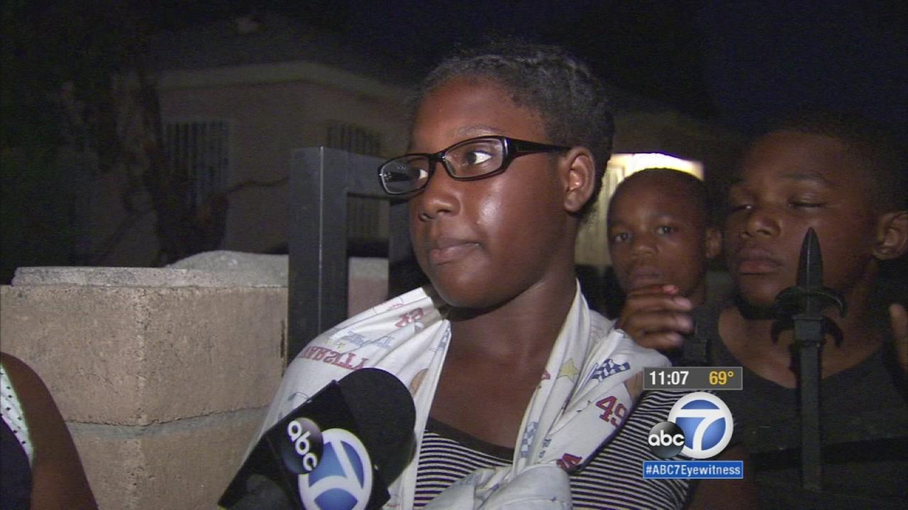 Teen girl shot, protects baby nephew in South Los Angeles