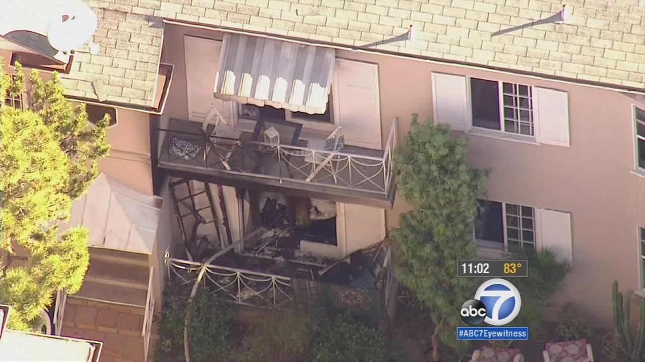 A homicide investigation was underway after a woman was found dead at the scene of an apartment fire near the UCLA campus in Westwood Monday, Sept. 21, 2015.