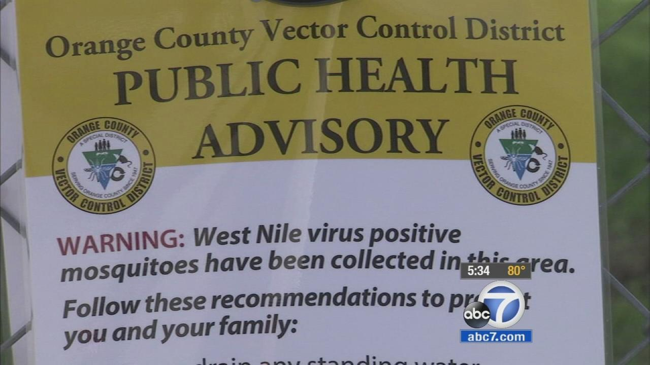 A warning sign posted at a Garden Grove park urges residents to be careful of West Nile virus-infected mosquitoes in the area.