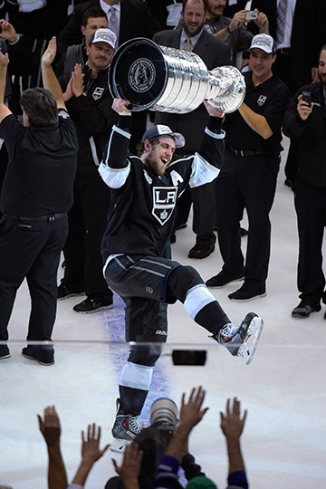 Los Angeles Kings center Anze Kopitar, of Slovenia, carries the Stanley Cup after beating the New York Rangers in double overtime in Game 5 of the NHL Stanley Cup Final series. <span class=meta>Stanley Cup</span>