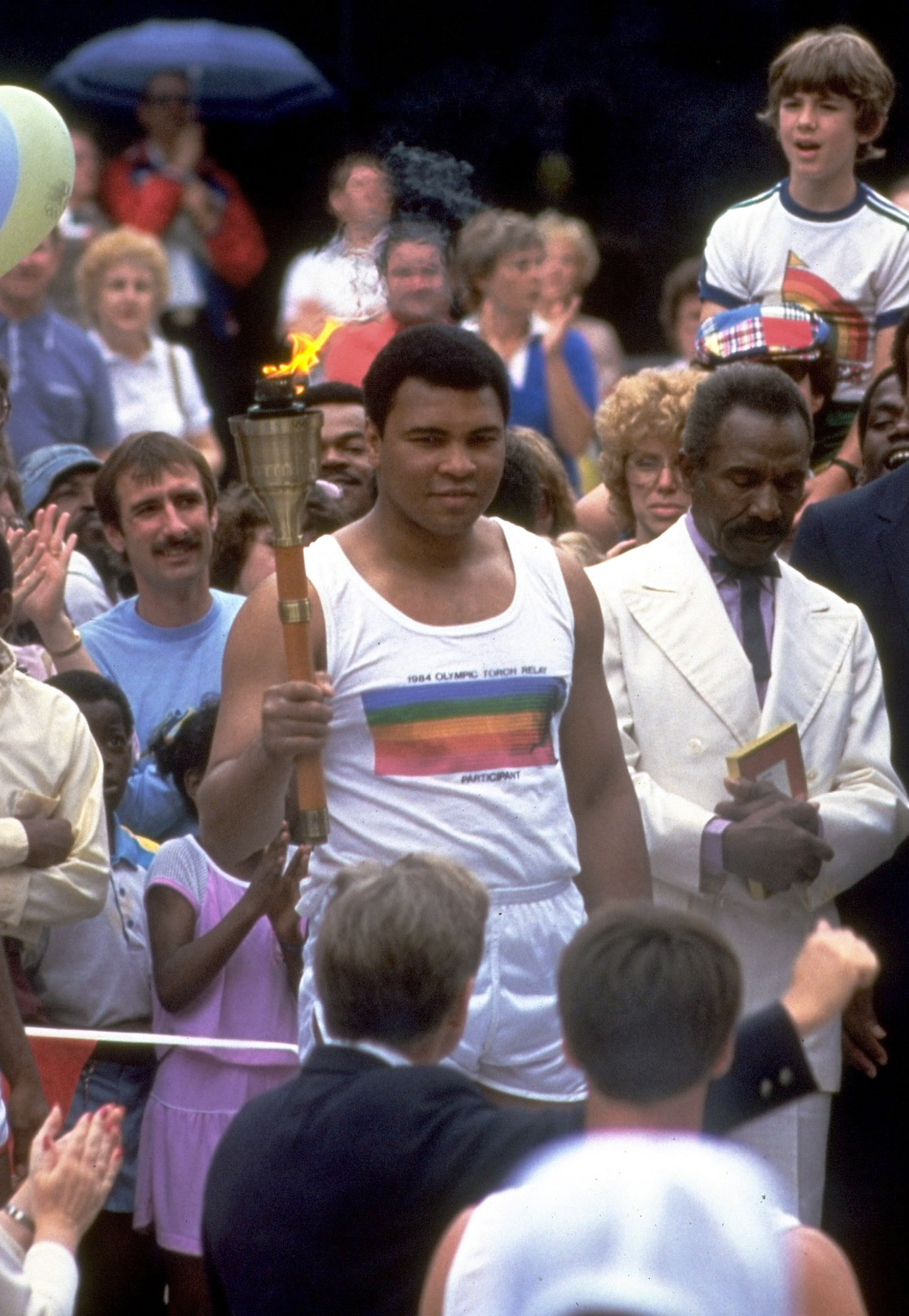 <div class='meta'><div class='origin-logo' data-origin='AP'></div><span class='caption-text' data-credit='AP Photo/File'>In this July 1984 file photo, former heavyweight champion Muhammad Ali carries the Olympic torch into the stadium in Los Angeles.</span></div>
