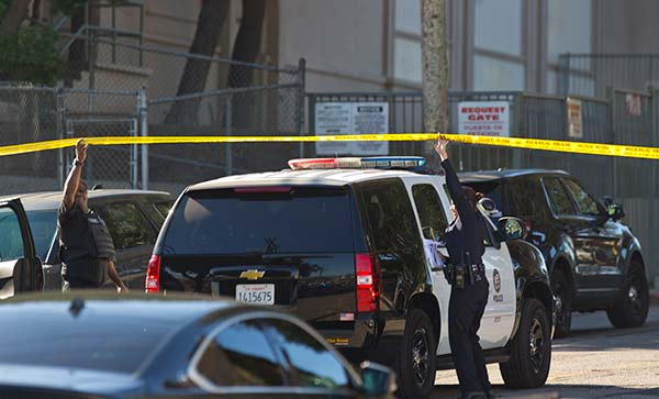 <div class='meta'><div class='origin-logo' data-origin='AP'></div><span class='caption-text' data-credit='AP Photo/Damian Dovarganes'>Los Angeles police cordon off the Belmont High School in Los Angeles Thursday, Feb. 1, 2018.</span></div>