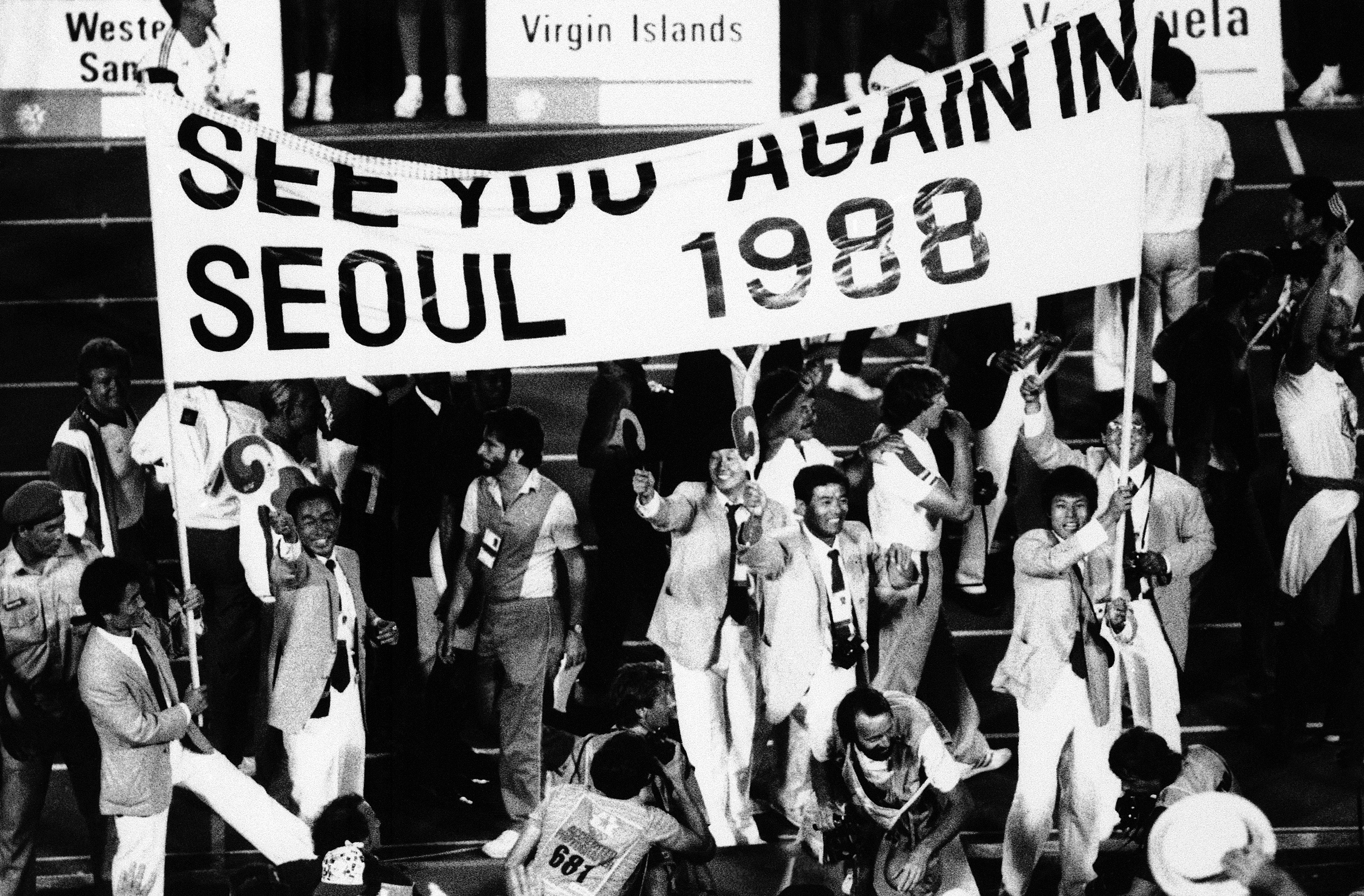 <div class='meta'><div class='origin-logo' data-origin='AP'></div><span class='caption-text' data-credit='AP Photo/Lionel Cironneau'>South Korean athletes hold a banner during the closing ceremonies of the XXIII Olympiad at the Coliseum in Los Angeles, Aug. 12, 1984.</span></div>